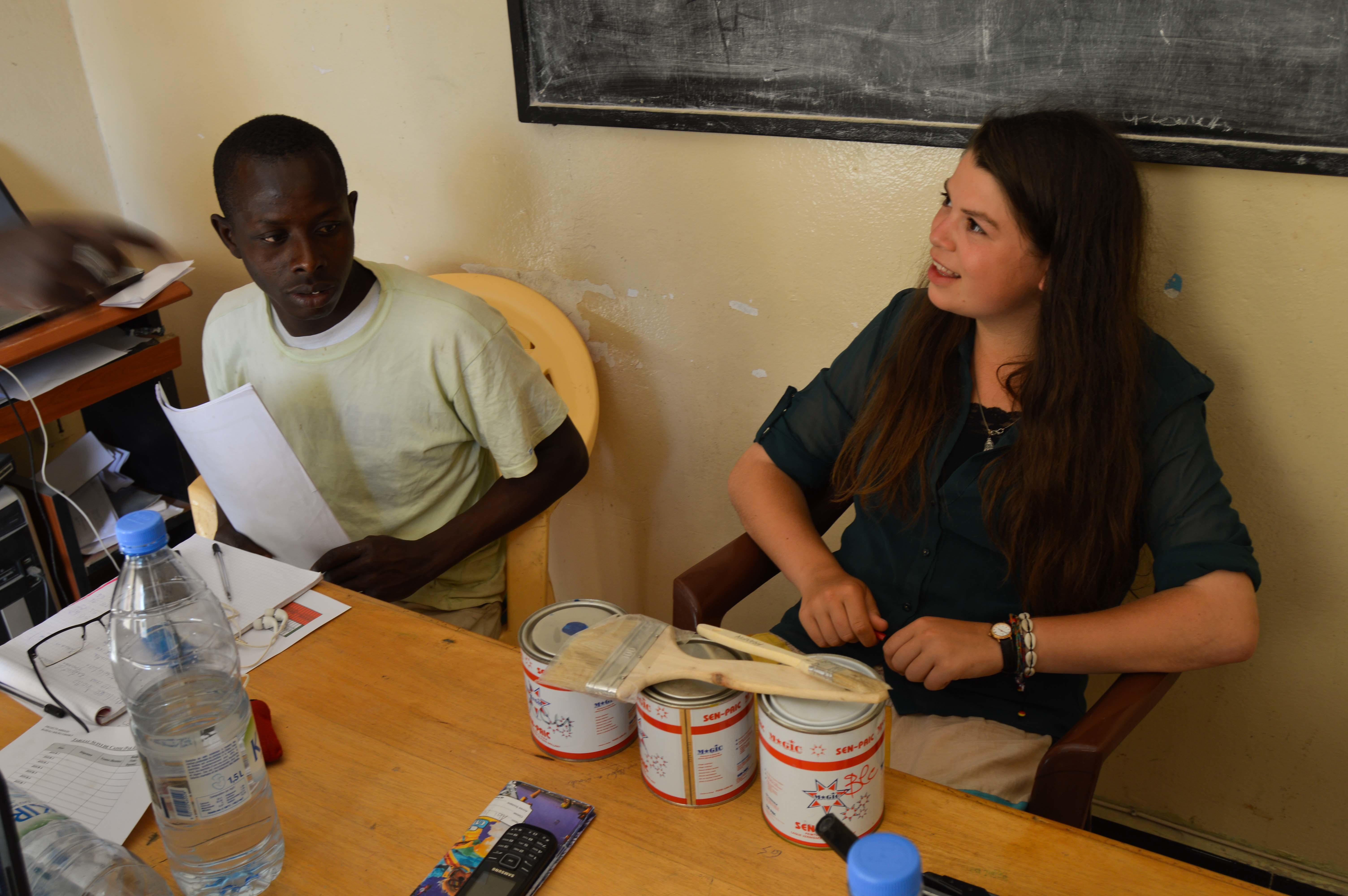 A student speaks with a project beneficiary during her Micro-finance internship in Senegal.